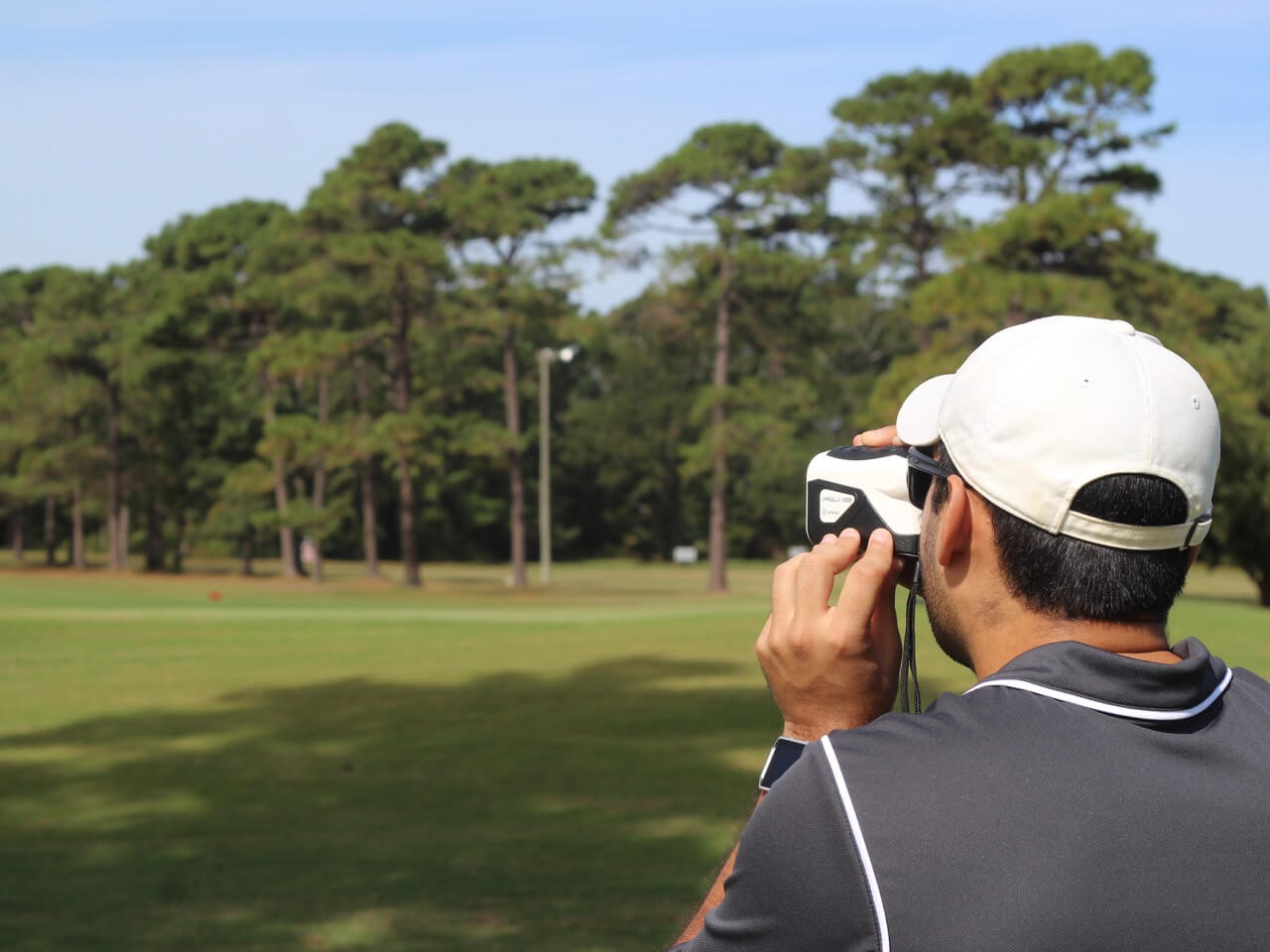 golf player with rangefinder